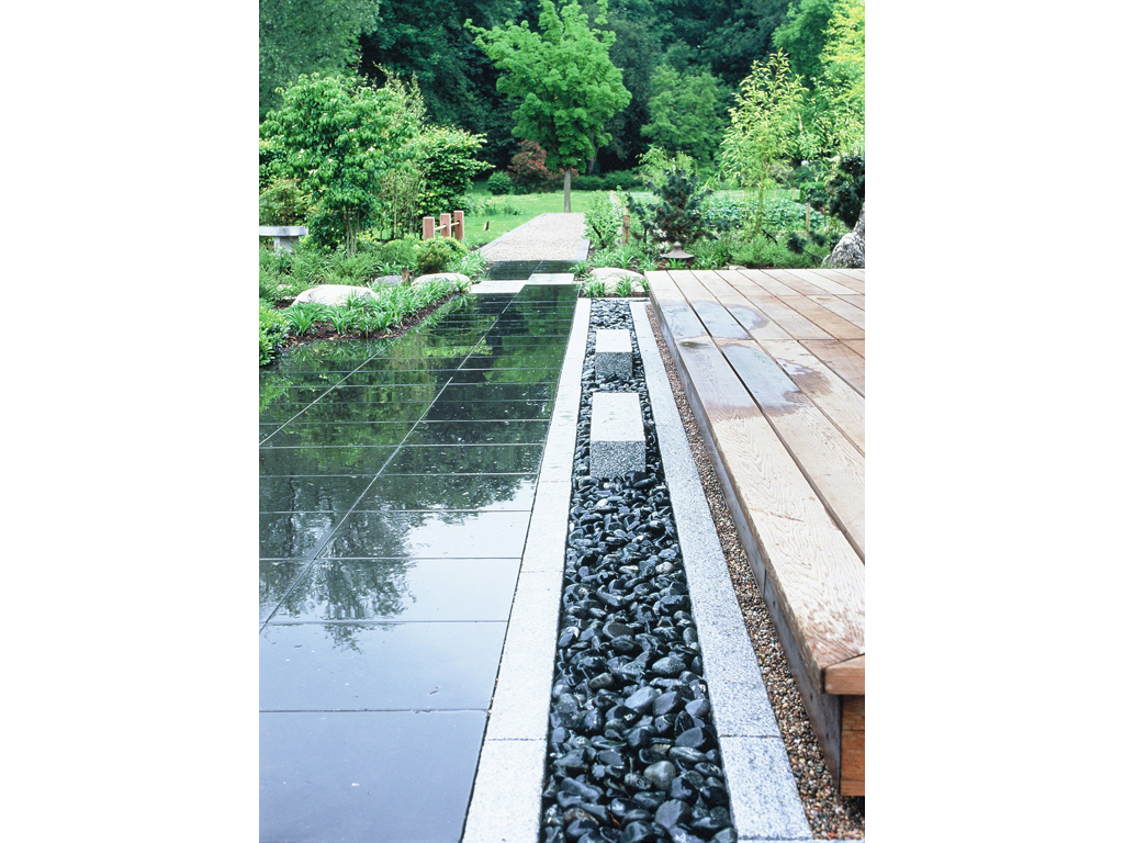Granite & pebble drainage detail designed by Acres Wild, Great Missenden, Buckinghamshire