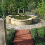 Formal water feature in a Mediterranean garden designed by Andrew Wenham MSGD