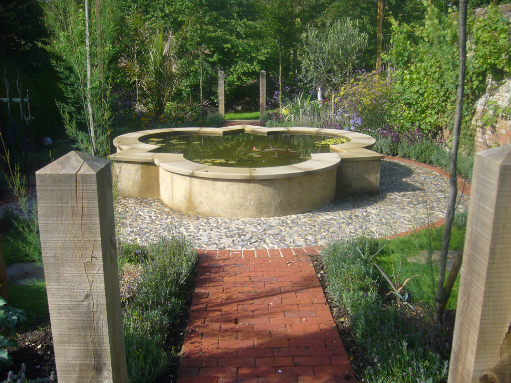 Formal water feature within a Mediterranean garden designed by Andrew Wenham MSGD