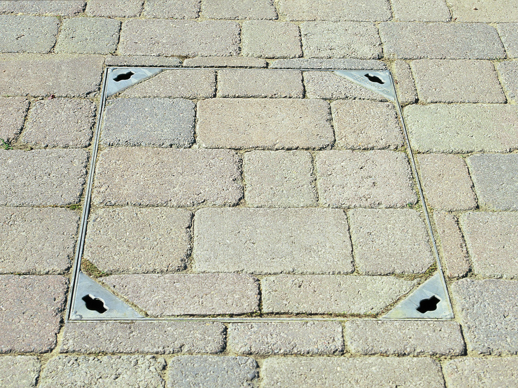 Landscape construction, manhole paving detail