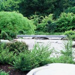 Granite bridge in Japanese garden Designed by Acres Wild