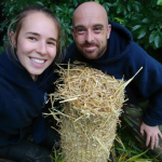 Two of our team getting a tree fern cosy for winter