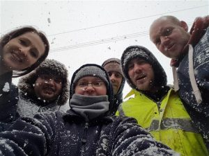 Image of work team in snow gear