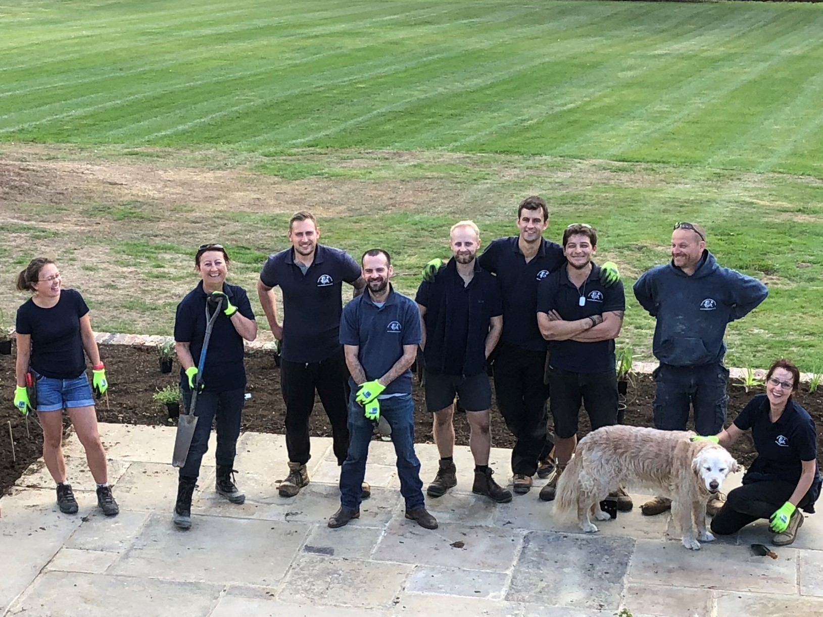 Garden Company team members setting out plants on a client site