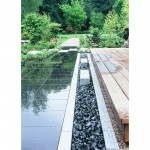 Granite & pebble drainage detail designed by Acres Wild