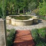 Formal water feature in a Mediterranean garden designed by Andrew Wenham MSGD