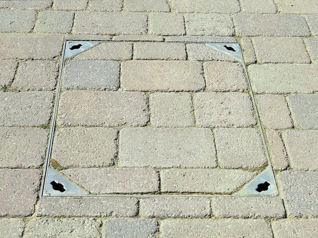 Landscape construction, manhole paving detail