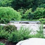 Granite bridge in Japanese garden Designed by Acres Wild